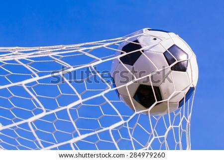 soccer ball hit the net,success goal concept - stock photo