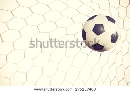 soccer ball in goal on white background vintage color - stock photo