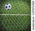 Soccer ball in goal, success concept - stock photo
