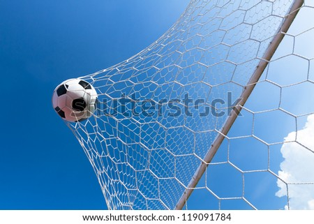 Soccer ball in goal, success concept - stock photo