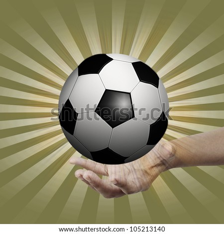 Soccer ball in hand. - stock photo