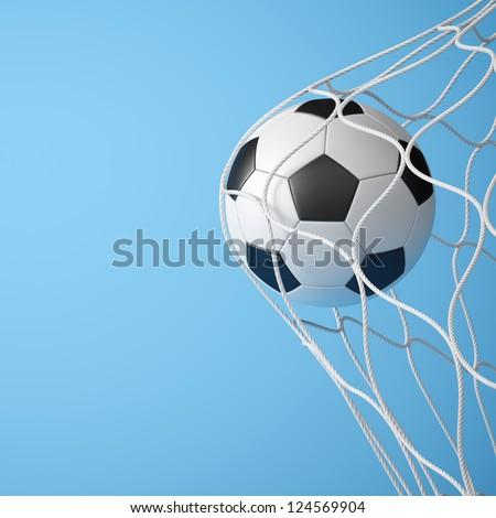 Soccer ball in net on blue background - stock photo