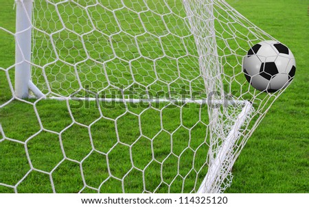 Soccer ball in the goal - stock photo