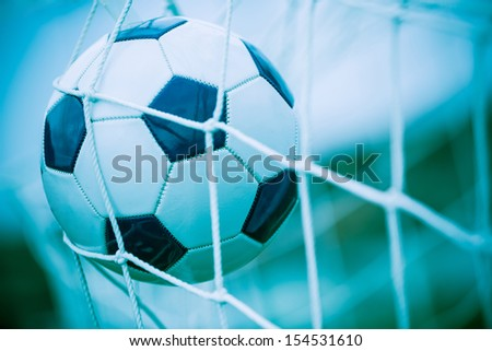 Soccer Ball into the Net - stock photo