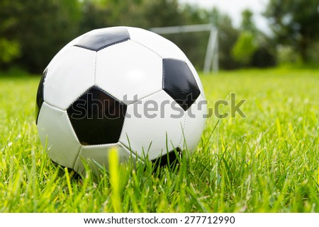 Soccer ball on a grass - stock photo