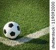 Soccer ball on artificial grass - stock photo