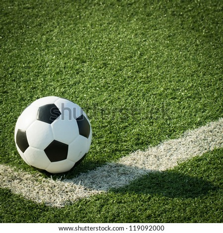 Soccer ball on artificial grass
