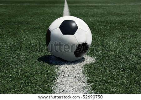 Soccer ball on center line of turf