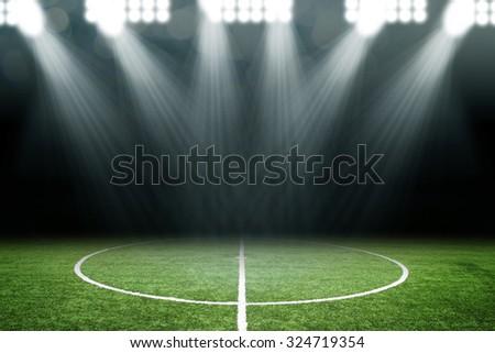Soccer ball on field in stadium - stock photo