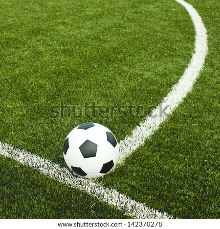 Soccer ball on field with copyspace for text