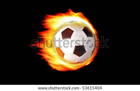 Soccer ball on fire isolated on black background - stock photo