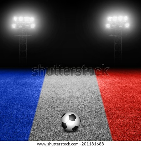 Soccer ball on french flag field against illuminated stadium lights - stock photo