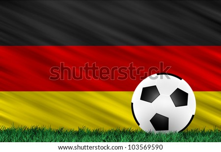 Soccer ball on grass field and  Germany flag