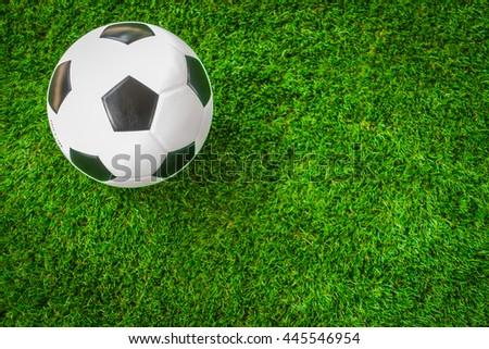 Soccer ball on green grass - stock photo