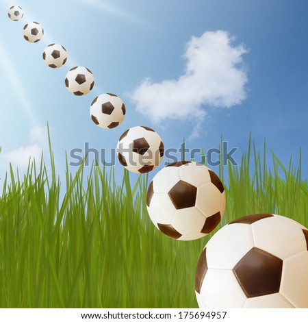 Soccer ball On Green Grass And Blue Sky With Heart Shape Cloud
