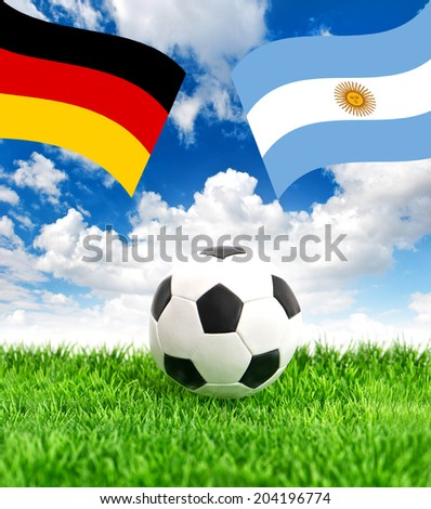 Soccer ball on green grass and national flags of Germany and Argentina over dramatic blue sky. Collage - stock photo