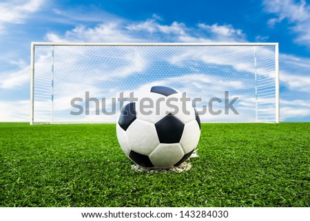 soccer ball on green grass field, penalty - stock photo