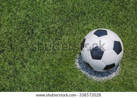 soccer ball on green soccer field grass background