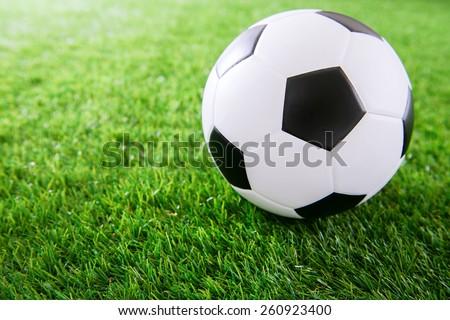Soccer ball on green turf - stock photo