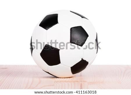 Soccer ball on the boards. Soccer ball closeup - stock photo