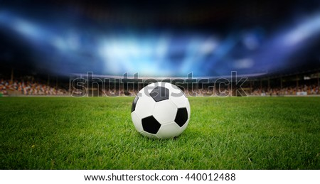 Soccer ball on the field of stadium - stock photo