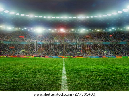 Soccer ball on the field of stadium with light . - stock photo