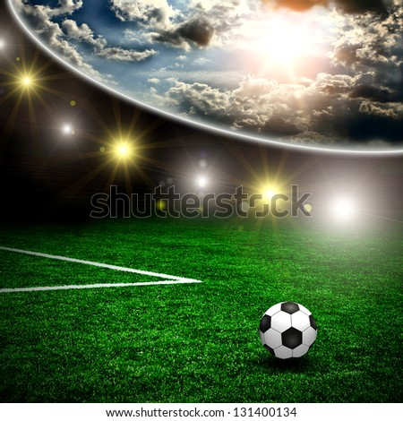 Soccer ball on the green field and lightning - stock photo