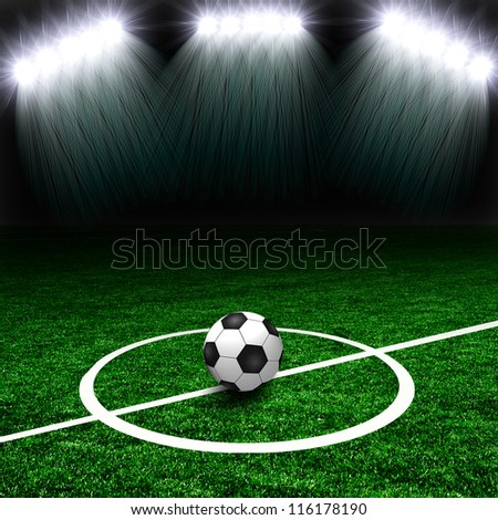 Soccer ball on the green field with lights - stock photo