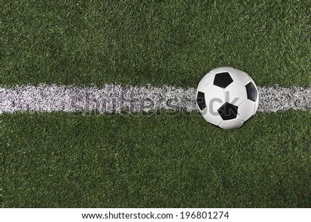 Soccer Ball on the midfield on a Soccer Field - stock photo
