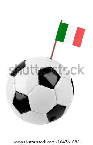 Soccer ball or football decorated with a small national flag of Italy on a tooth stick - stock photo