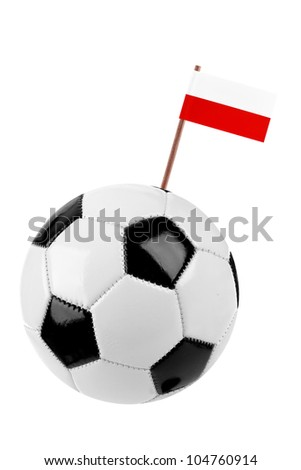 Soccer ball or football decorated with a small national flag of Poland on a tooth stick - stock photo