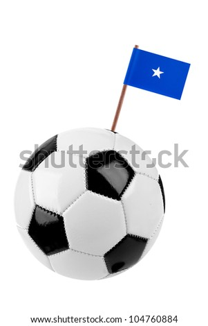 Soccer ball or football decorated with a small national flag of Somalia on a tooth stick - stock photo