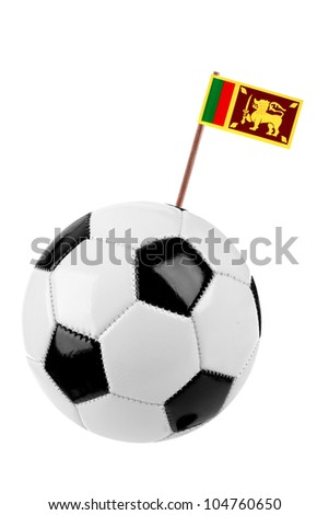 Soccer ball or football decorated with a small national flag of  Sri Lanka on a tooth stick - stock photo