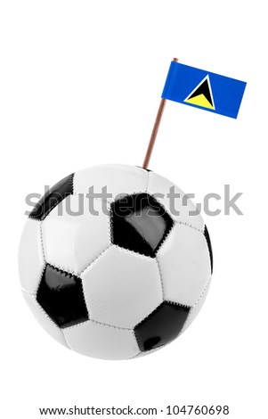 Soccer ball or football decorated with a small national flag of St. Lucia on a tooth stick - stock photo