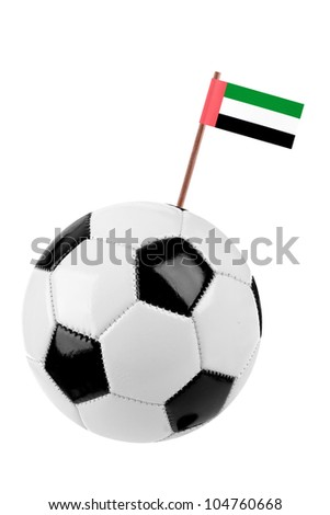 Soccer ball or football decorated with a small national flag of United Arab Emirates on a tooth stick - stock photo