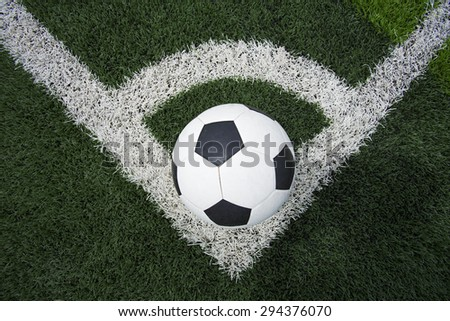 soccer ball or football on soccer field - stock photo