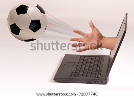 Soccer Ball out of the computer Screen. - stock photo