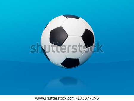 Soccer ball over blue background
