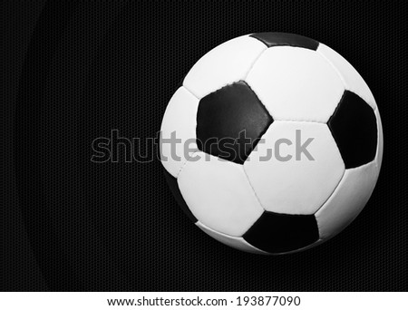 Soccer ball over dark background - stock photo