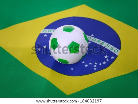 soccer ball with Brazil flag background