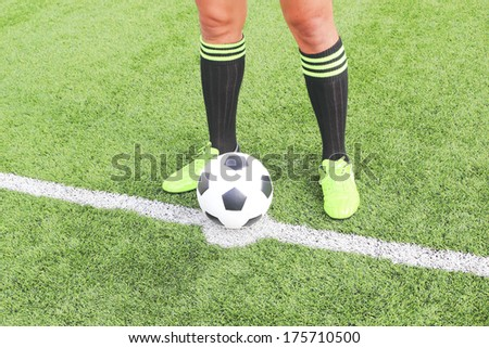 soccer ball with foot of player kicking it - stock photo