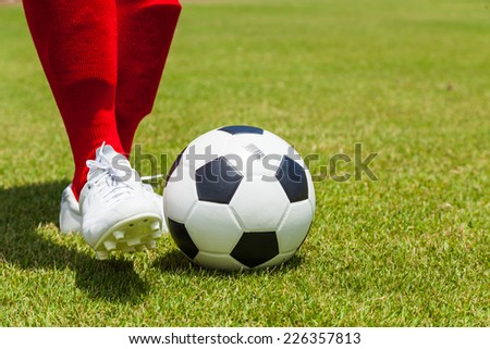 soccer ball with foot of player kicking it