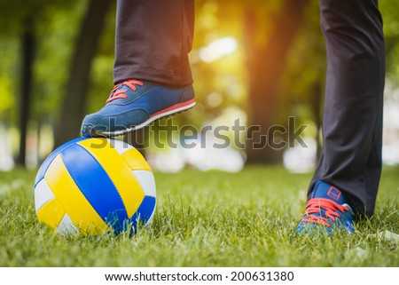 soccer ball with foot of player touching it - stock photo