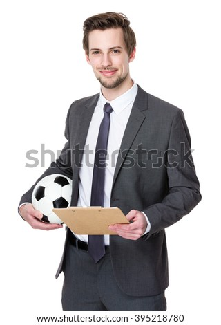 Soccer coach with clipboard and ball - stock photo