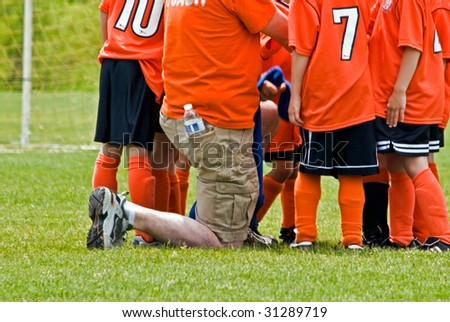 soccer coach with team - stock photo