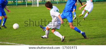 Soccer competition. Blue and white uniform. Sun weather. - stock photo