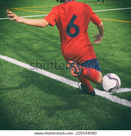 Soccer corner kick with retro effect. - stock photo