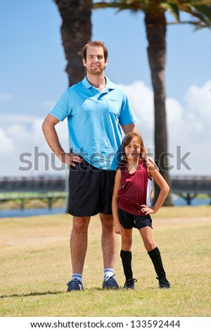 soccer dad and daughter practicing in the field healthy sporty lifestyle