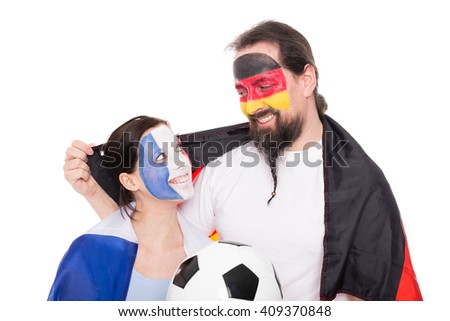 Soccer Fans from France and Germany are hugging, Football and Flags, isolated on white - stock photo