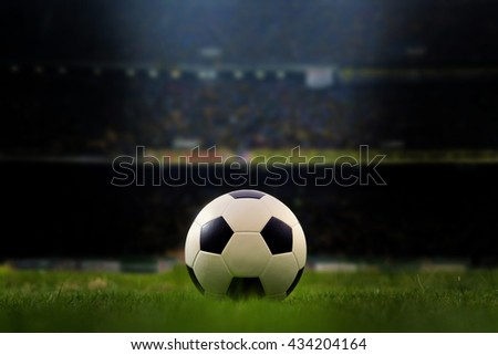 soccer field and stadium with fans the night before the match, soccer stadium, soccer match, soccer on grass, soccer football, soccer team, soccer sport, soccer ball, soccer at night, soccer arena. - stock photo